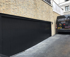Side sliding garage doors