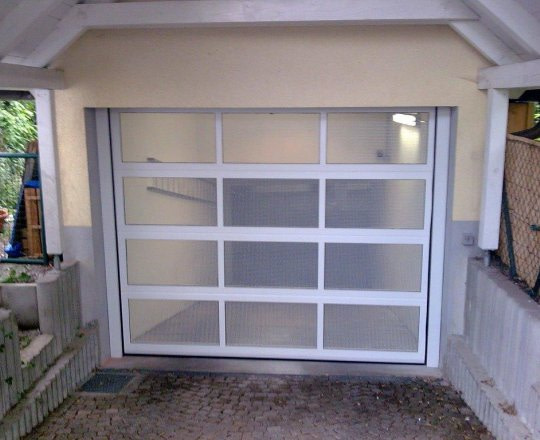 Sectional garage doors SD-24, white color.