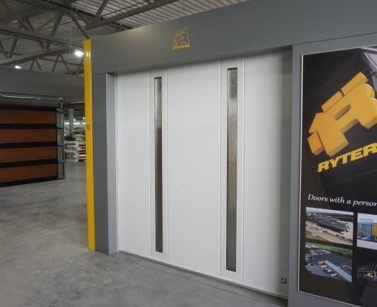 Side sliding garage doors